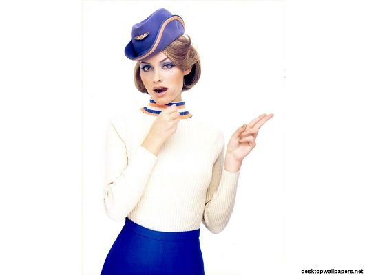 click to free download the wallpaper--Beautiful TV/Movie Photos, Amber Valetta in Airline Stewardess Suit, Appealing Pose