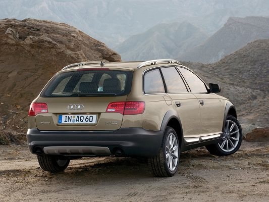 click to free download the wallpaper--Best Cars Image, Audi A6 Allroad Turning a Corner, Tall Brown Hills Around