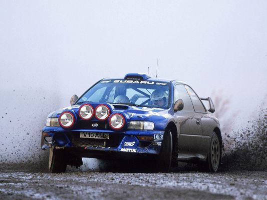 click to free download the wallpaper--Best Cars as Wallpaper, Subaru Impreza Rally Car, Heavy Smoke Behind