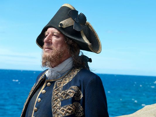 click to free download the wallpaper--Best Films Wallpaper, Pirates Of The Caribbean, Old Man Facing the Blue Sea