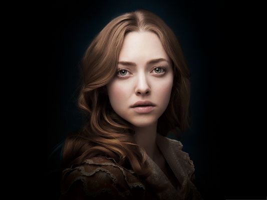 click to free download the wallpaper--Best Movies Post, Amanda Seyfried as Cosette, a Touching Film
