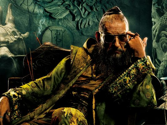 click to free download the wallpaper--Best Movies Poster of Iron Man 3, Well-Dressed Mandarin, in Meditation