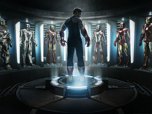 click to free download the wallpaper--Best Movies Wallpaper, Iron Man 3, Robert Downey Jr Waiting to be Equipped