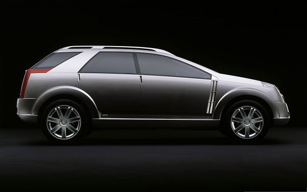 click to free download the wallpaper--Cadillac Cars Image, Brown Super Car on Dark Backgroud, Decent and Nice