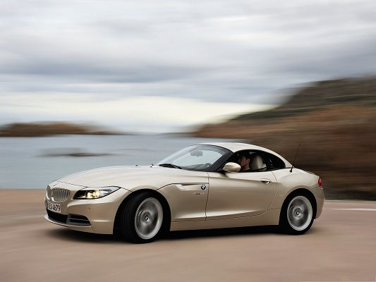 click to free download the wallpaper--Car Images Background, BMW Z4 Car in Great Speed, Amazing Scenery