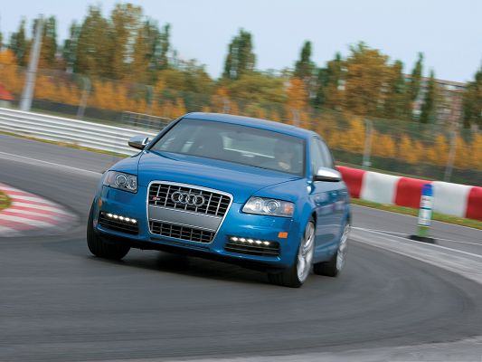 click to free download the wallpaper--Car Images for Desktop, Blue Audi S6 Sedan Car Turning a Corner, Great Speed