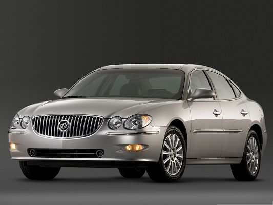 click to free download the wallpaper--Car Images for Desktop, Brown Buick Car on Dusk Background, Great in Look