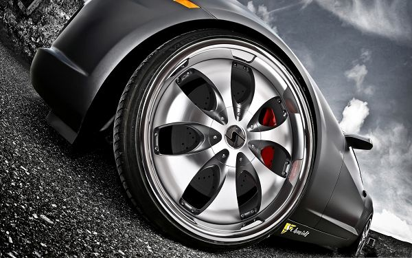 click to free download the wallpaper--Car Rim Wallpaper, Gray and Shinning Wheel on Black Road, Under the Blue Sky