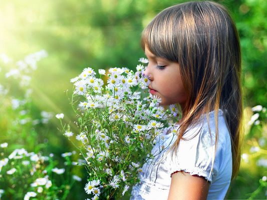 click to free download the wallpaper--Child and Flowers, Young Girl Around Tiny White Flowers, Happy Outdoor