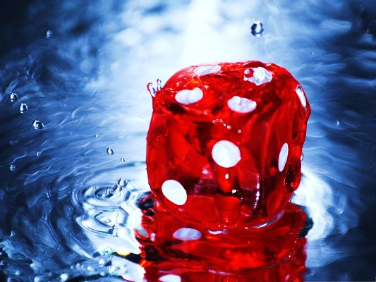 click to free download the wallpaper--Computer Wallpapers HD, Red Dice About to Melt, Blue Background