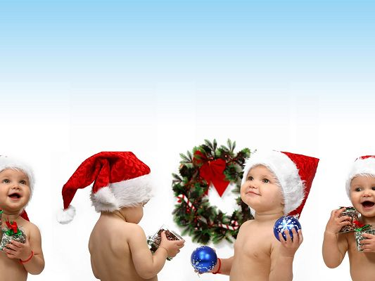 Cute Babies Image, 4 Santa Kids, Each With Christmas Gift, All Happy and Satisfied on Christmas Day