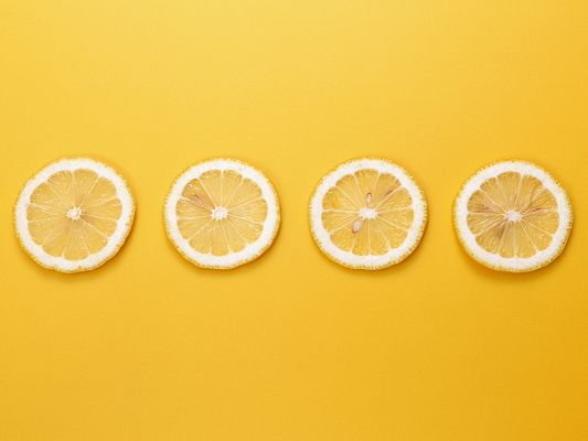 Cute Fruits Wallpaper, 4 Lemons in a Line, Yellow Background, Incredible Scene