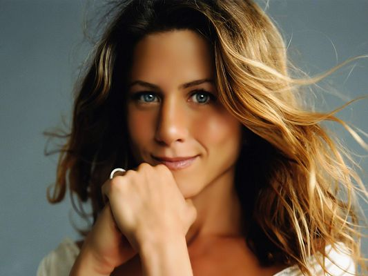 Dancing and Flying Hair, Hands are Held in Fist, She Must be Happy and Praying for Other's Good - HD Jennifer Aniston Wallpaper