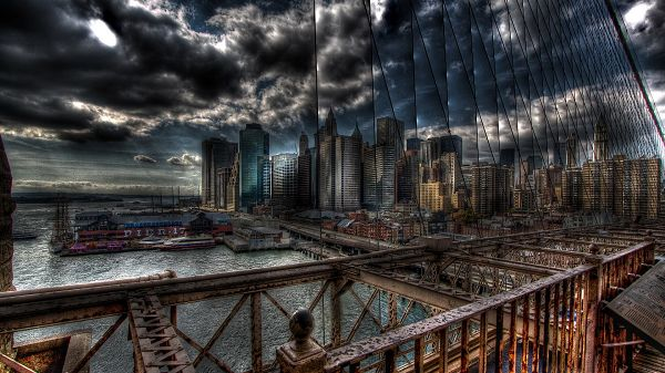 click to free download the wallpaper--Depressing City Scenes - Tall Buildings Added with Gloomy Atmosphere, the Dark and Cloudy Sky, a Large Bridge