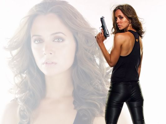 Eliza Dushku 37 HD Post in 1600x1200 Pixel, Girl in Black Suit and Gun, Background is Herself, an Amazing Look - TV & Movies Post