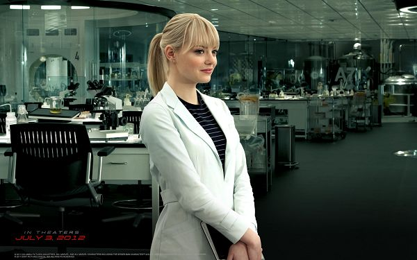 click to free download the wallpaper--Emma Stone as Gwen Stacy in 1680x1050 Pixel, Standing Upright and Smiling, She Shall Fit Multiple Devices - TV & Movies Wallpaper