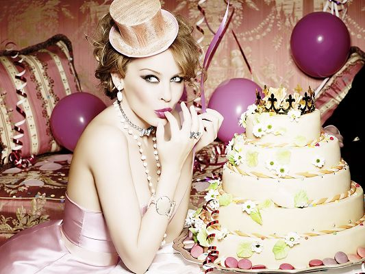 click to free download the wallpaper--Enjoying Cake on Birthday Party, the Pink Dress Makes Her a Sweet Princess, Very Impressive Look - HD Kylie Minogue Wallpaper