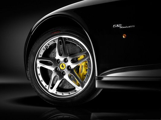 click to free download the wallpaper--Ferrari Sport Car, Black Super Car Turning a Corner, You Know It is Great
