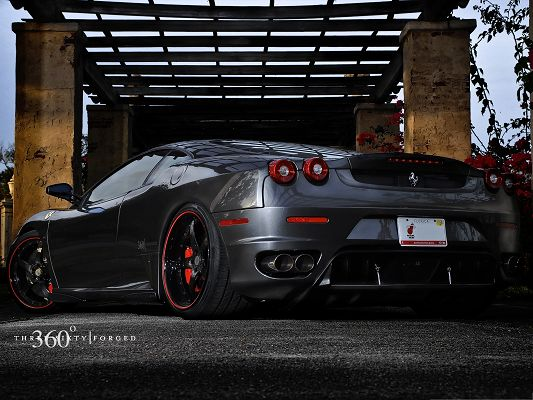 click to free download the wallpaper--Ferrari Sport Car as Background, Gray Car About to Turn a Corner, Typical Symbol