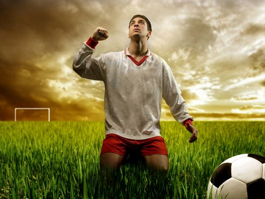 click to free download the wallpaper--Football and Player Images, a Player Kneeling Down, Thank God for the Shot