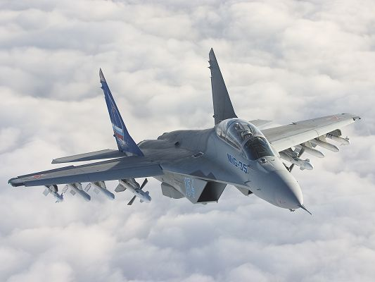 click to free download the wallpaper--Free Aeroplanes Wallpaper, MIG-35 On Air, Soft White Clouds Around