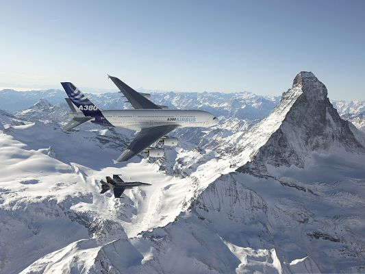 click to free download the wallpaper--Free Aircrafts Wallpaper, F 18 Hornet And Airbus Flying Over Snow-Capped Mountains