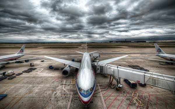 click to free download the wallpaper--Free Aircrafts Wallpaper, Super Plane in the Airport, the Cloudy Sky Above