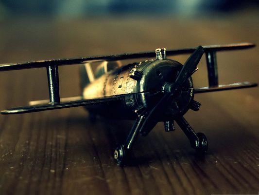 click to free download the wallpaper--Free Airplane Wallpaper, Old Plane Toy, Wooden Background