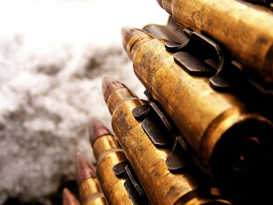 click to free download the wallpaper--Free Ammunitions Pic, a Pile of Bullets, a Realistic Way, Under the Dark Sky, They Are Impressive