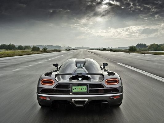 click to free download the wallpaper--Free Car Wallpaper, Koenigsegg Agera on Straight and Wide Road, Run Far!