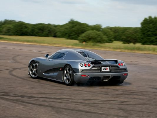 click to free download the wallpaper--Free Car Wallpapers, Koenigsegg CCX Among Nature Landscape, Rear And Side Look