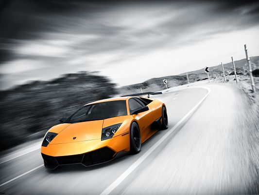 click to free download the wallpaper--Free Cars Wallpaper, Murcielago Superveloce in the Run, About to Turn a Corner