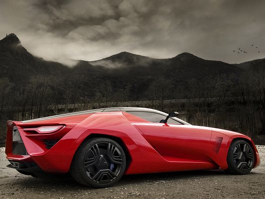 click to free download the wallpaper--Free Cars Wallpaper, Red Supercar Under Tall and Dark Hills