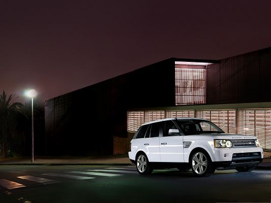 click to free download the wallpaper--Free Cars Wallpaper, White Range Rover Car Standing by a Lighted House