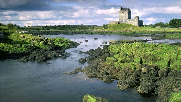 click to free download the wallpaper--Free Download Natural Scenery Picture - All Green Plants by the Clear River, a Tall Castle Reaching the Blue Sky