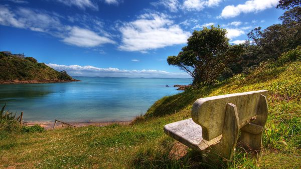 click to free download the wallpaper--Free Download Natural Scenery Picture - The Blue Sky and the Blue Sea, a Stone Chair by Its Side, Everything is Shadowed