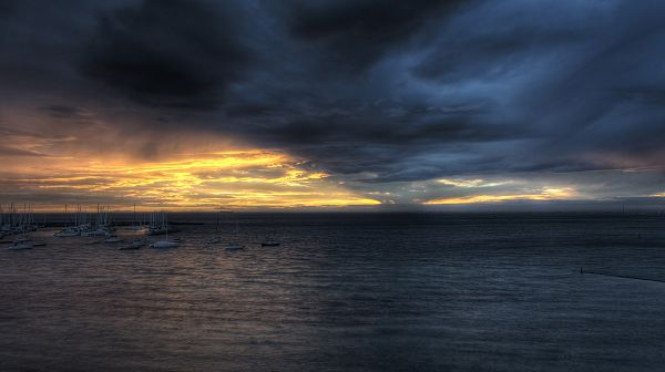 Free Download Natural Scenery Picture - The Dark Sky, Sunlight Breaking in, the Sea is Not Clear