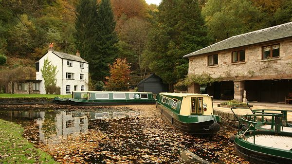 Free Download Natural Scenery Picture - Two Boats in Stop, Green and Natural Plants Alongside, Seemingly Empty Houses