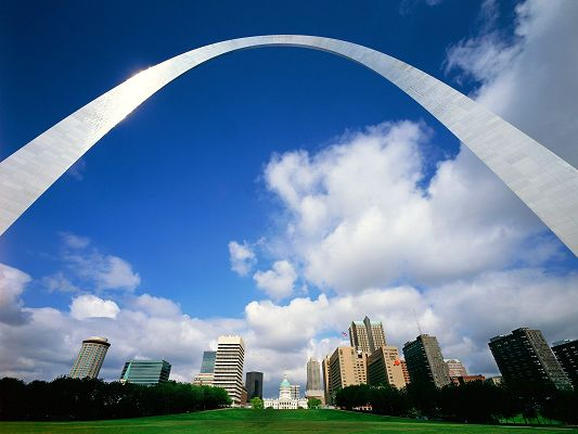 click to free download the wallpaper--Free Download Natural Scenery Wallpaper - Gateway Arch Wallpaper, a Bright and Shinning Gateway Above Great Natural Sceneries