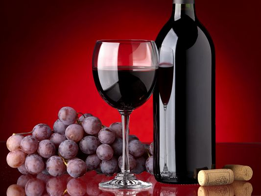 click to free download the wallpaper--Free Fruits Wallpaper, Red Wine Bottle, Ripe Grapes Around
