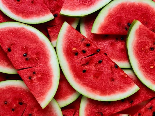 click to free download the wallpaper--Free Fruits Wallpaper, Sliced Watermelon, Red and Delicious