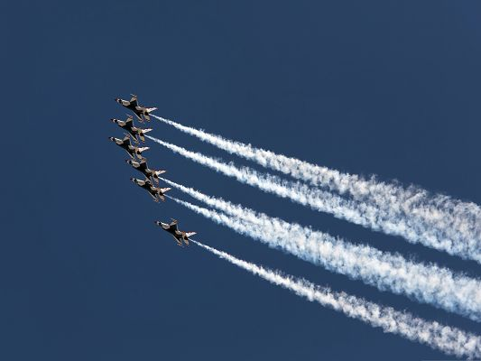 click to free download the wallpaper--Free Planes Wallpaper, Air Parade, Thick Smoke in the Blue Cloudless Sky
