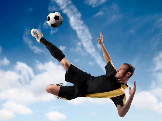 click to free download the wallpaper--Free Sports Wallpaper, Football Player Kicking The Ball, Handsome Pose