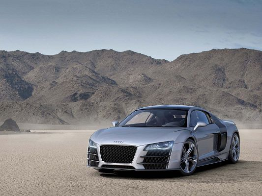 click to free download the wallpaper--Free Super Cars Wallpaper, Audi R8 on Seemingly Desert, Sharp Eyes and Smooth Lines