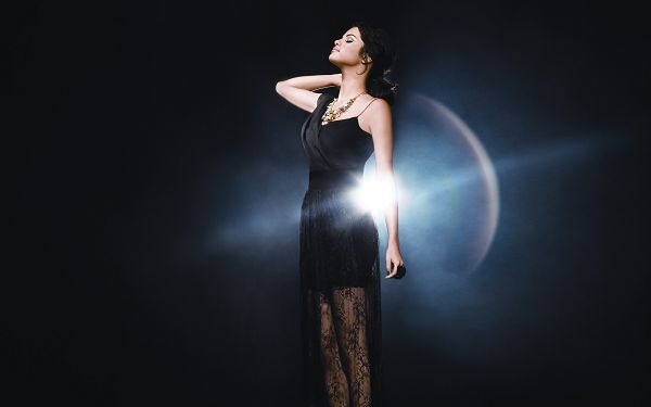 click to free download the wallpaper--Free TV & Movies Post - Selena Gomez Post in Pixel of 2560x1600, Girl in Black Dress, Shinning Planet Behind Her, She is Like Goddess