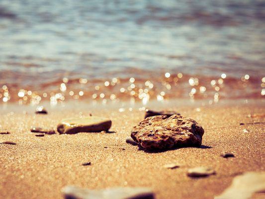 click to free download the wallpaper--Free Wallpaper Backgrounds, Beach Pebbles, Shinning Sand and Water