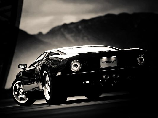click to free download the wallpaper--Free Wallpaper Backgrounds, Black Ford GT About to Turn a Corner, in Smooth Lines