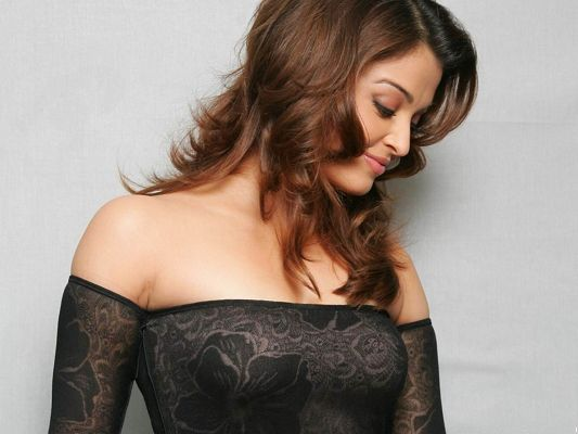 click to free download the wallpaper--Gorgeous TV & Movies Post, Aishwarya Rai in Hot Suit, Curly Hair, Amazing in Look