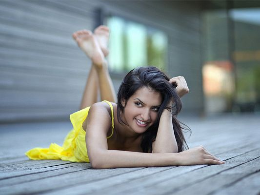 Gorgeous TV Show Photos, Brunette Lying on Floor, Big and Warm Smile