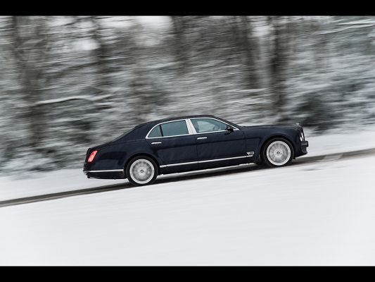 click to free download the wallpaper--Graceful Cars Image of Bentley Mulsanne, on a Snowy Slope, Trees Sweeping Past